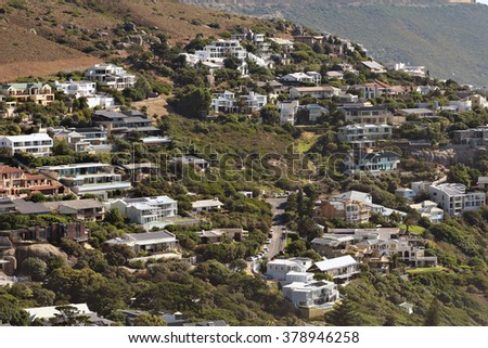 Luxury houses and mansions on the side of a cliff in Llandudno, Cape Town, South Africa. - stock photo