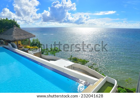 luxury infinity swimming pool with sea view   - stock photo