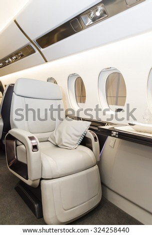 Luxury interior in bright colors of genuine leather in the aircraft business aviation - stock photo