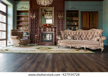 Luxury interior of home library. Sitting room with elegant furniture - stock photo