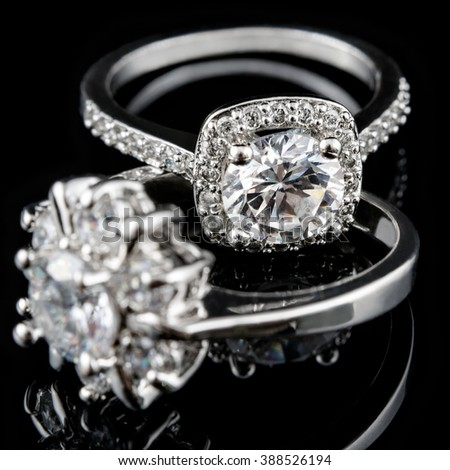 Luxury jewelry. White gold or silver engagement rings with diamonds closeup. Selective focus - stock photo