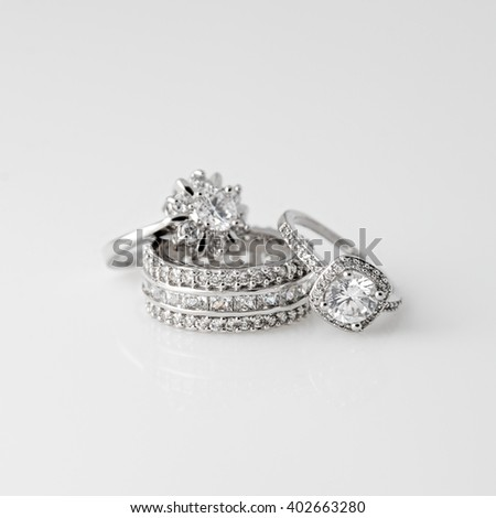 Luxury jewelry. White gold or silver rings with diamonds. Selective focus. - stock photo