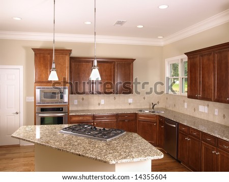 Luxury Kitchen corner with island stove - stock photo