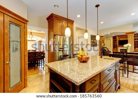 Luxury Kitchen With Light Brown Cabinets, Steel Appliances, Pantry, Marble  Counter Top Island