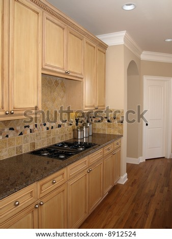 Luxury Kitchen with light colored wood