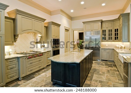 luxury kitchen with new cabinets and slate floor - stock photo