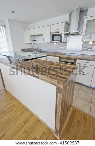 luxury kitchen with serving area and breakfast bar - stock photo