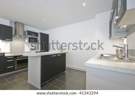 luxury kitchen with two counters and separate working isle - stock photo