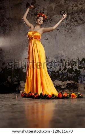 Luxury lady in long silk dress - stock photo