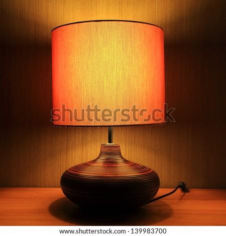 Luxury lamp on table - stock photo