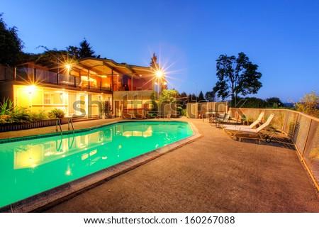 Luxury large home grounds with swimming pool. Summer Northwest evening. Lake Washington view. Seattle. - stock photo