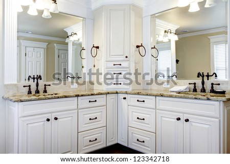 Luxury large white master bathroom cabinets with double sinks. - stock photo
