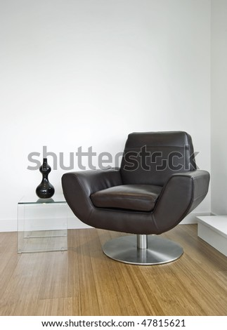 luxury leather armchair with glass side table and decoration - stock photo
