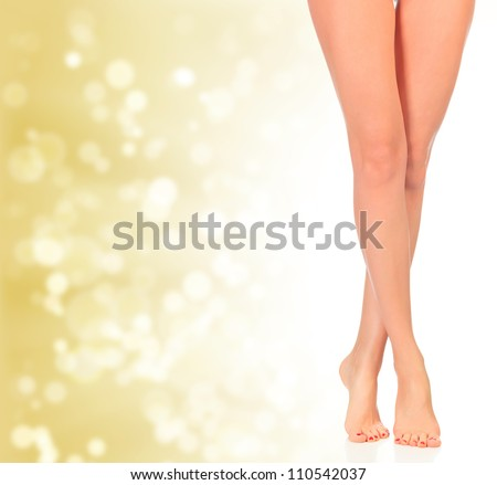 Luxury legs on golden background with blurred lights