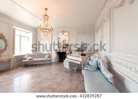 Luxury light interior of sitting room with old stylish vintage furniture.