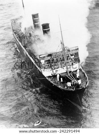Luxury Liner Morro Castle, smoldering off Asbury Park, New Jersey. On its final Havana to New York voyage, a storm and ship fire resulted in the death of 135 passengers and crew. September 1934. - stock photo