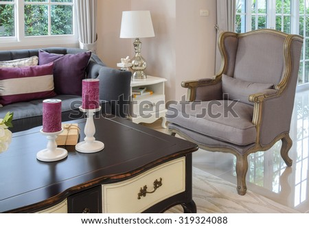 luxury living room design with classic sofa, armchair and decorative table lamp - stock photo