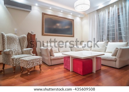 Luxury living room with modern ceiling lights - stock photo