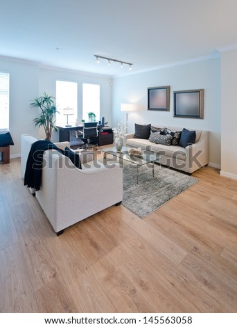 Luxury living room with the laminate floor. Interior design. - stock photo