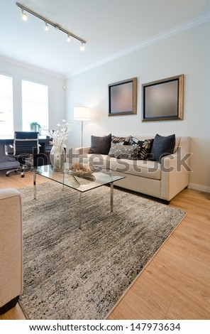 Luxury living suite. Living, family room with the decorative vase on the glass coffee table and the couch and pillows. Interior design.  Vertical. - stock photo