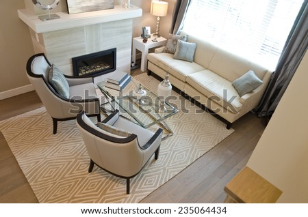 Luxury living suite: two modern chairs at the coffee table. View from above. - stock photo
