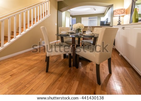 Luxury living suite with nicely decorated dining table and the living room at the back.  Interior design. - stock photo