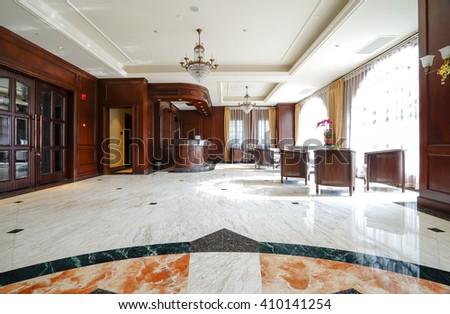Luxury lobby interior.With crystal lamp,bing hall, marble floor, french sash,mosaic tile,comfortable sofa, etc. - stock photo