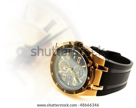 luxury man watch against vintage clock silhouette. Copyspace for your text - stock photo