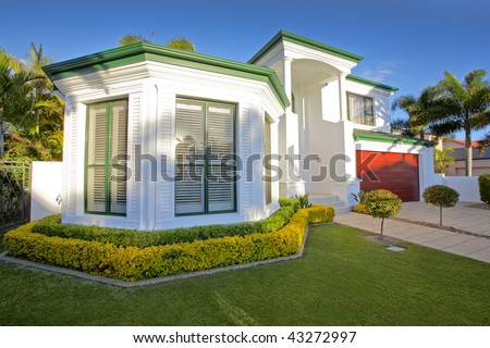 Luxury mansion house front in suburban district - stock photo