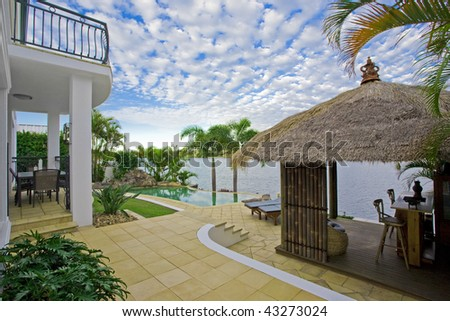 luxury mansion outside deck with Bali hut, bar and pool
