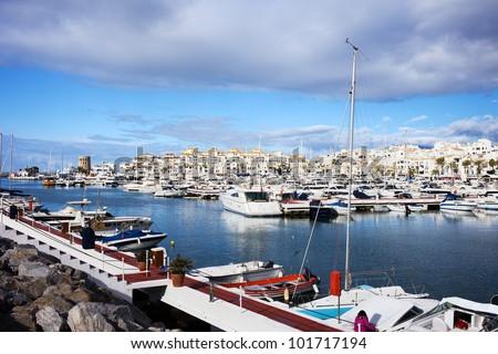 Luxury marina in Puerto Banus on Costa del Sol, near Marbella in southern Spain, Andalusia region, Malaga province - stock photo