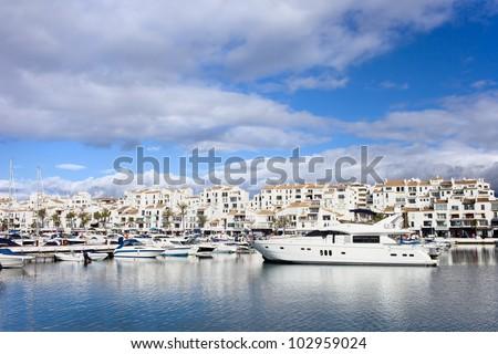 Luxury marina in Puerto Banus on Costa del Sol, near Marbella in southern Spain, Andalusia region, Malaga province. - stock photo