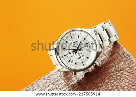 Luxury men's watch against colored background