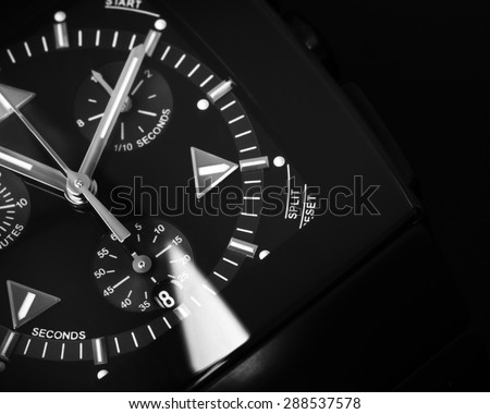 Luxury mens Chronograph Watch made of black high-tech ceramics with sapphire glass. Close-up studio photo with selective focus - stock photo