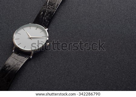 Luxury mens watch made of black high-tech ceramics. Close-up studio photo with selective focus. - stock photo