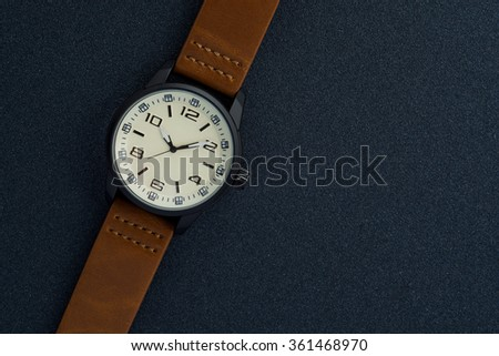Luxury mens watch made of black high-tech ceramics. Close-up studio photo with selective focus - stock photo