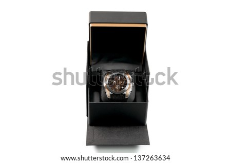 Luxury mens wristwatch displayed and packaged in a box as a gift for a celebration on a white background - stock photo