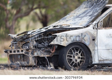 Luxury model car destroyed in a fire deliberately lit by vandals - stock photo