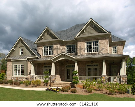 Luxury Model Home Exterior with stormy weather