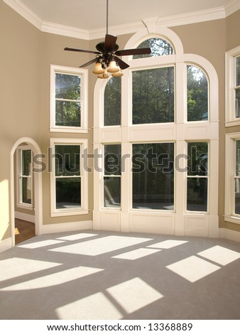 Luxury Model Home Living Room with Arched Window Wall - stock photo