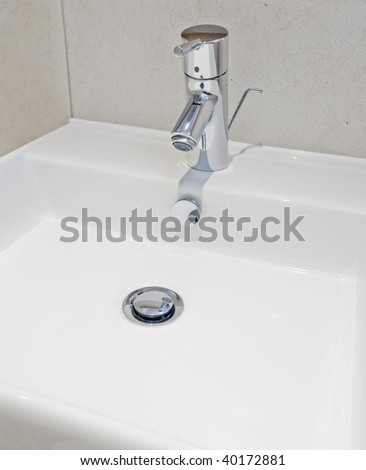 Luxury modern bathroom detail with designer water mixer tap - stock photo
