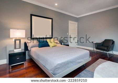 Luxury modern home bedroom. King size bed with hand-woven natural colored fine sisal runner, rug. - stock photo