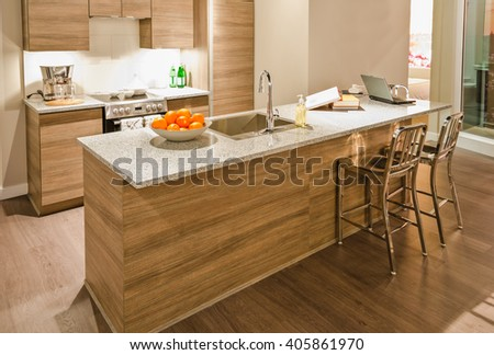 Luxury modern kitchen. Counter with the vase with some fruits.  Interior design.