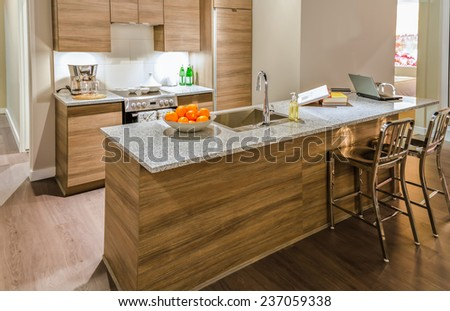 Luxury modern kitchen. Counter with the vase with some fruits on it. Interior design. - stock photo