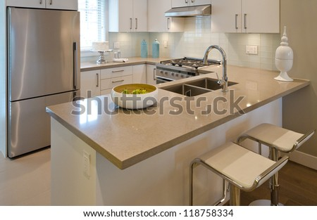 Luxury modern kitchen with the dish with some pears on the counter. Interior design - stock photo