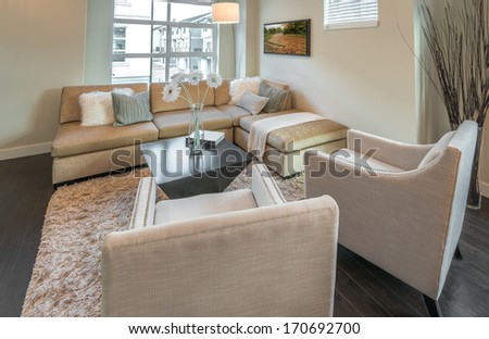 Luxury modern living suite, room with sofa and chairs.  Interior design of a brand new townhouse. - stock photo