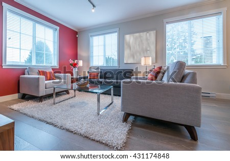 Luxury modern living suite, room with sofa and chairs, nicely decorated with vase and a coffee table. Interior design. - stock photo
