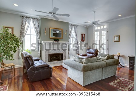 Luxury modern livingroom with firplace and furniture - stock photo