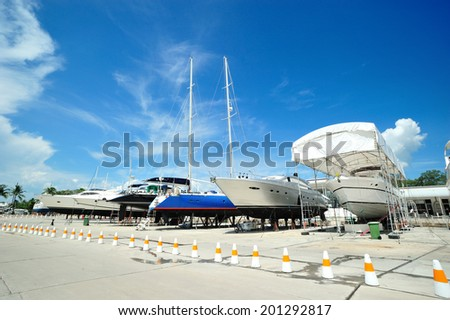 Luxury motor yacht beached at a dock for painting and repair