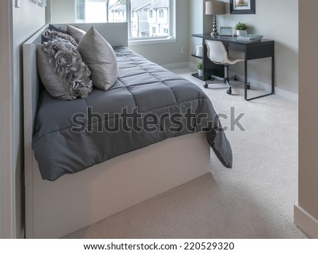 Luxury nicely decorated modern comfortable bedroom.  Interior design of a brand new house. - stock photo